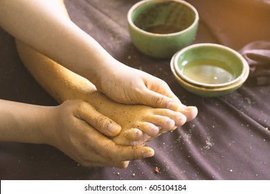 Foot massage with relaxation oil, herbs and salt in Spa salon