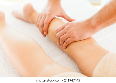 Foot massage in the spa salon