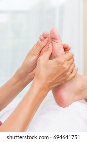 Foot massage in spa salon ,Thai massage.