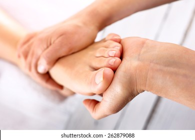Foot massage in the spa salon.Woman in a beauty salon for pedicure and foot massage.