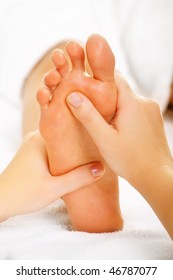 Foot massage and spa foot treatment.