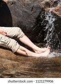 Foot massage under a waterfall