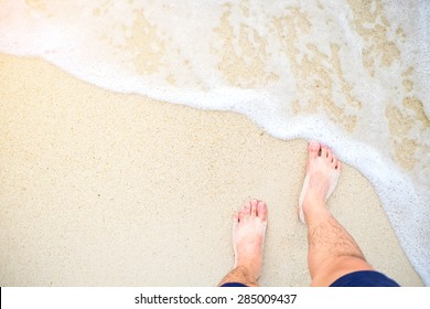 Foot on the beach , top view