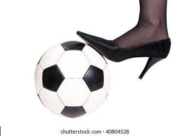Foot on black white football or soccer sport ball