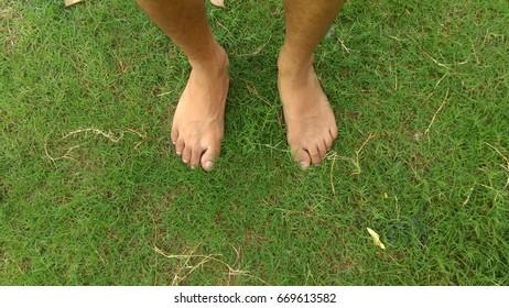 foot on green grass