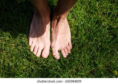 Foot over green grass