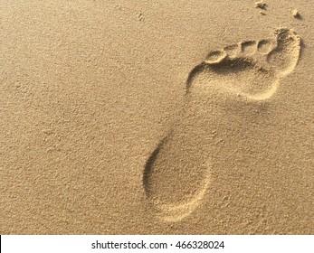foot print on sand beach travel concept