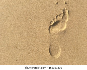 foot print on sand beach texture background travel concept