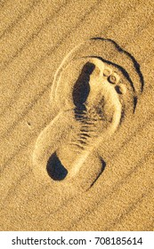 Foot print in sand on a beach