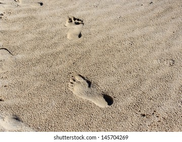 Foot prints on the sandy beach at Port Bouvard Western Australia on a fine but cloudy morning in mid winter.