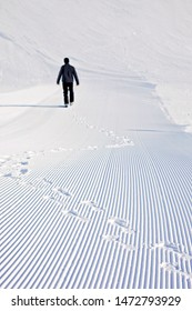 Foot prints in the snow, snow lines made by a snow machine on a ski slope