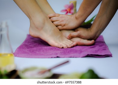 Foot Reflexology, Spa Therapy and Foot Spa Products. White background. Select White and soft focus