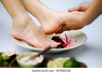 Foot Reflexology. Spa treatment and product for feet spa with white background.select and soft focus.
