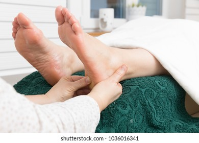 foot reflexology at a woman foot