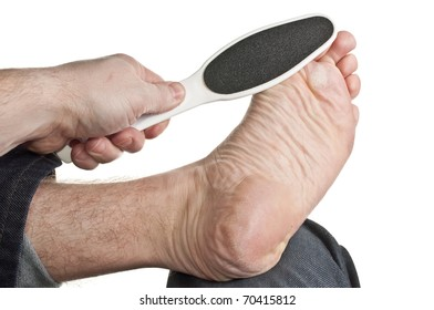Foot resting on knee getting spa treatment
