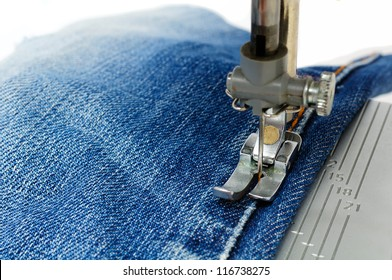 Foot of Sewing Machine on Jeans Fabric