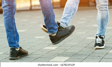 Foot shake style of greetings. Prevention of fight against pandemic. Quarantine methods to control spread of coronavirus. New greeting style during coronavirus outbreak. People bump feet outdoors.
