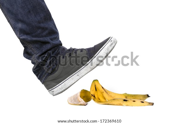 Foot, shoe about to slip on banana peel and have an accident