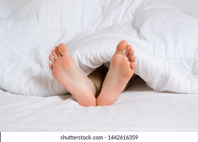 Foot of someone sleeping in a bed