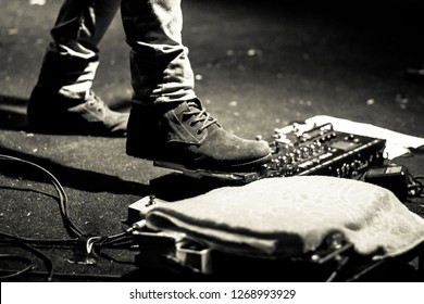 Foot Stepping on a Guitar Pedal Effect
