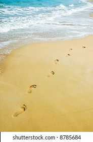 foot steps on the beach in the tropics