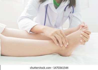 Foot swelling  And excessive weight And massage therapy Fatigue  in pregnant women and doctor on bed