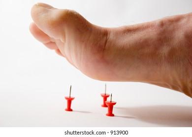 Foot and tacks - illustrating foot pain