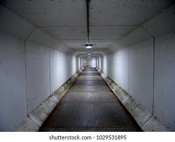 Foot tunnel at night