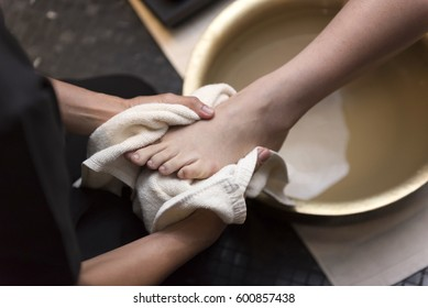 Foot washing in spa before treatment