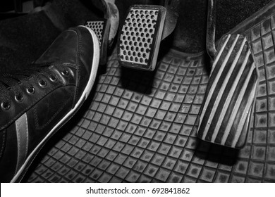 Foot while driving a clutch pedal to control the speed of the drive.
