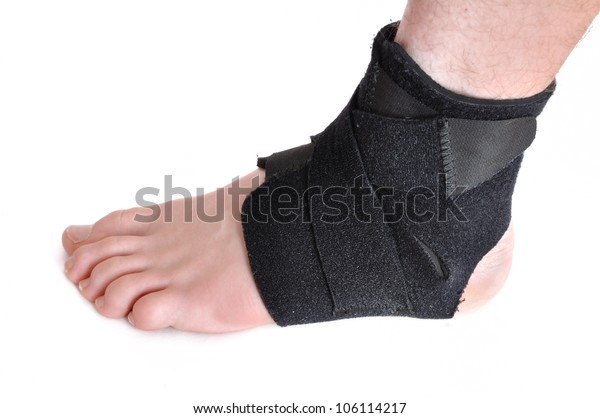 Foot Wrapped in a Black Ankle Brace Isolated on White