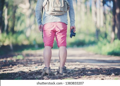 foot of young Man Traveler with backpack relaxing outdoor with rocky mountains on background Summer vacations and Lifestyle hiking concept.