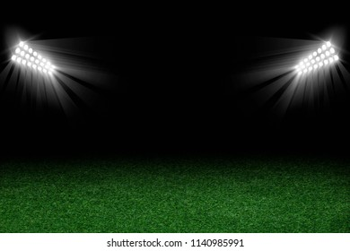 Football arena field with bright stadium lights