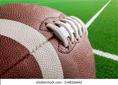 Football ball on grass