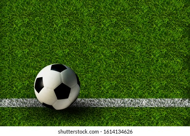 A football ball on the green lawn