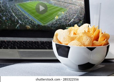 football bowl of chips at a computer with a video broadcast sports fan men, sports, view, home, food Football broadcast