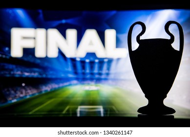 "Football Champions League trophy silhouette and tittle ""FINAL"" in background"