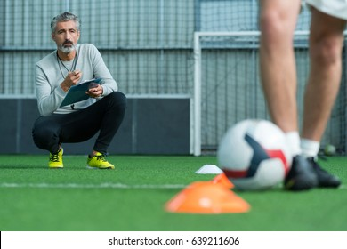football coach training football player