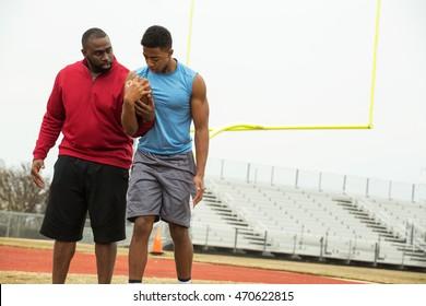 Football coach training and teaching football.