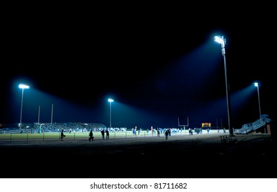 football competition at night in stadium