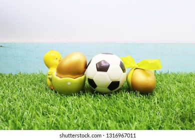 Football Easter on green grass for soccer holiday