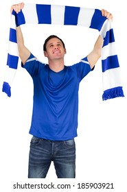 Football fan in blue holding scarf on white background