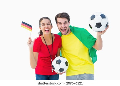 Football fan couple cheering and smiling at camera on white background