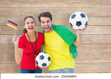 Football fan couple cheering and smiling at camera against wooden surface with planks
