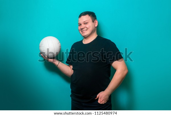 Football fan, happy man with a white ball for soccer. Football payer.