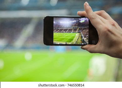 Football fan removes the football game on mobile smartphone
