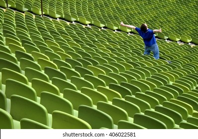 Football fan in stadium. Sport concept, background.