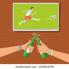 Football fans in the bar. Soccer fans watch the match on TV. Hands toasting with bottles of beer. Raster version.