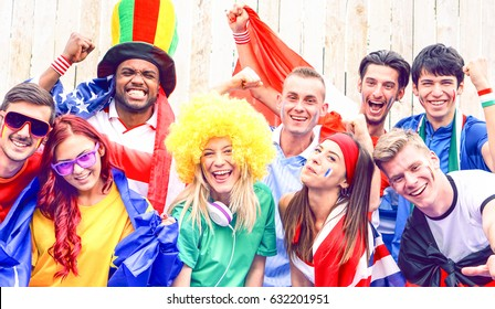 Football fans cheering together watching game - Community of soccer supporters friendly singing and screaming at stadium - Concept of brotherhood togetherness and friendship in sports and life