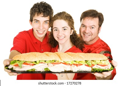 Football fans holding a giant submarine sandwich.  Isolated on white.